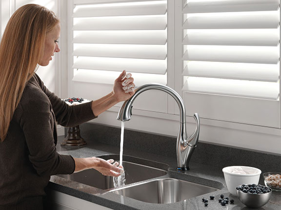 Woman Drawing Water From Kitchen Sink