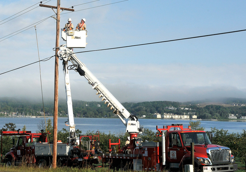 line truck and linemen working