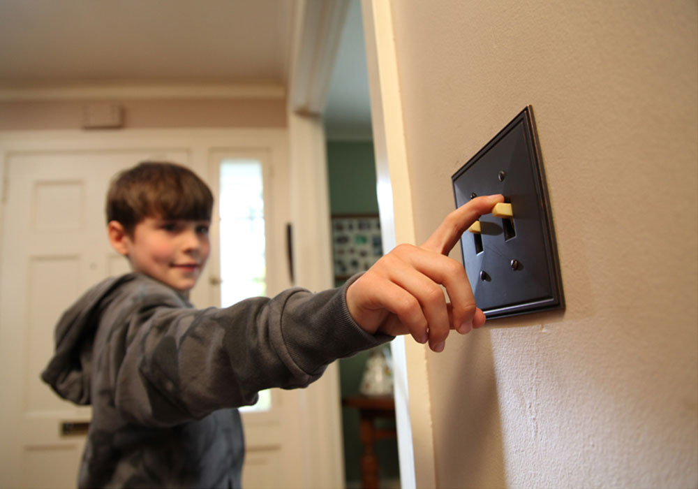 Boy flipping light switch