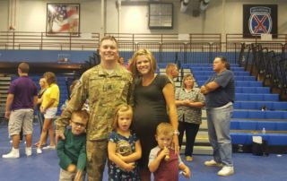 military member with family