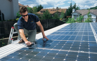 man installing solar on rooftop