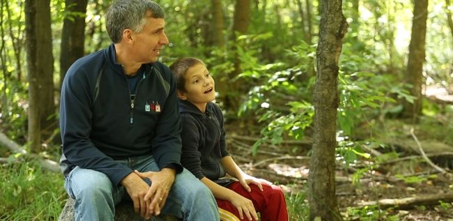 man and boy in woods